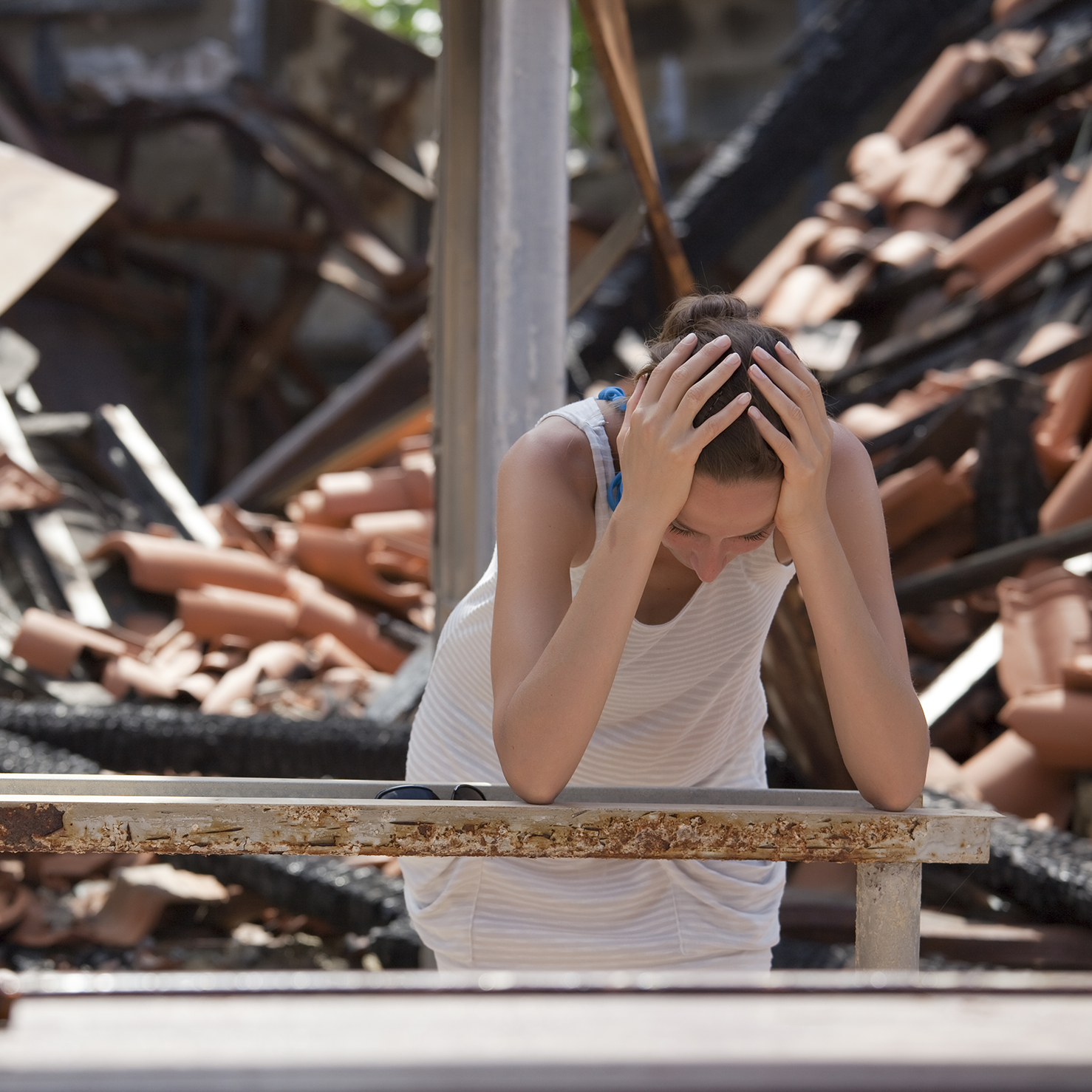 woman-stressed-over-burned-out-home